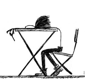 scruffy drawing of a big nosed stickman leaning on a desk.